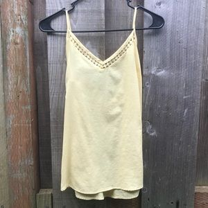 The limited pale yellow sleeveless top
